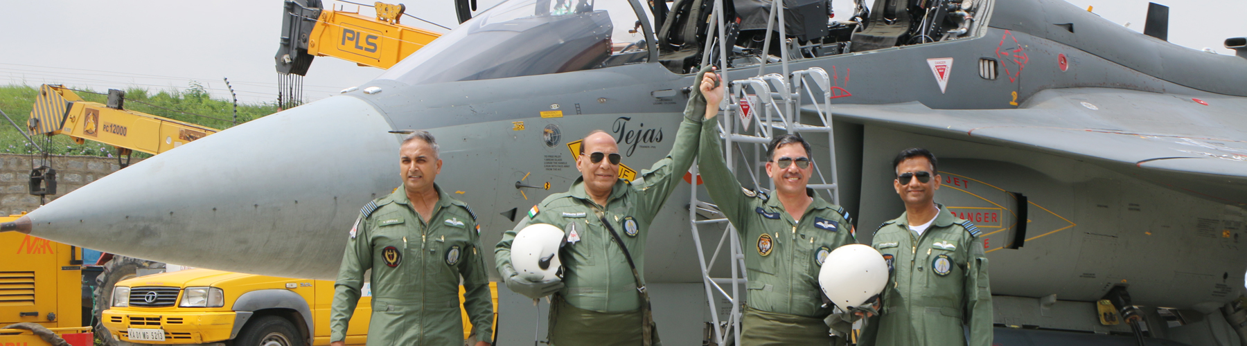 Raksha Mantri Shri Rajnath Singh after his maiden sortie in LCA Tejas with Air Vice Marshal Narmdeshwar Tiwari at HAL Airport, Bengaluru on Thursday, September 19, 2019