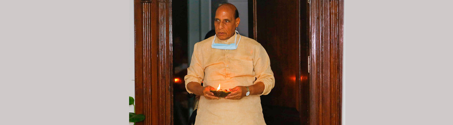 Raksha Mantri Shri Rajnath Singh joins the nation by lighting lamps for nine minutes at 09:00 PM expressing his solidarity to fight COVID-19, on a call given by Prime Minister Shri Narendra Modi, in New Delhi on Sunday, April 05, 2020